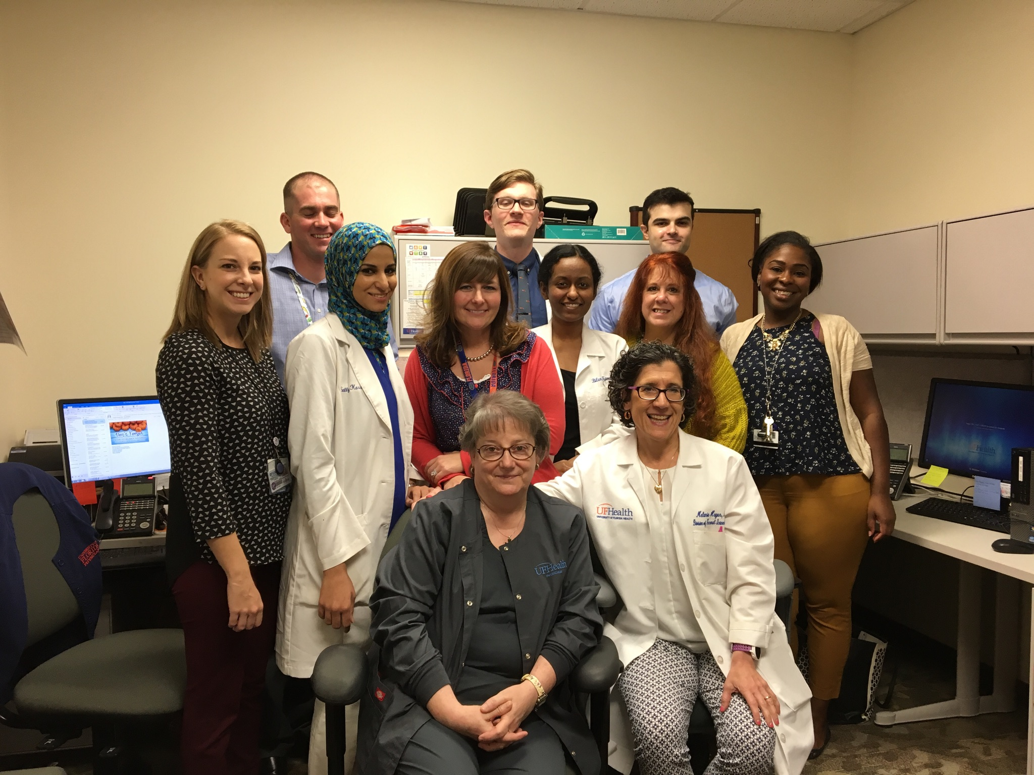 Recently participating on the Transitions of Care team are, from left to right, front row: Maryann Grottano, RN, BSN, health coach, & Melanie Hagen, MD, FACP. Second row: Stephanie G. Smith, Ph.D.; Sally Kassem, pharmacy student; Katherine Vogel Anderson, PharmD., BCACP; Belin Kassu, medical student; Lee Collopy, LCSW; & Tiffany Phillips, MSW, RCSWI; social worker. Back row: Andrew Courtney, Homecare business development representative; Sean Moore, PA student; & Daniel Cordiner, MD, PGY-1 resident. Not pictured: Ryan Nall, MD
